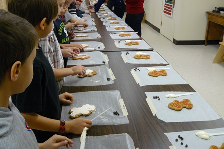 School group decorating gingerbread cookies.
