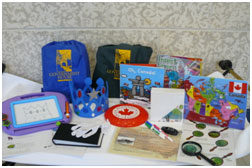 Contents of Discovery Backpacks displayed on a table.