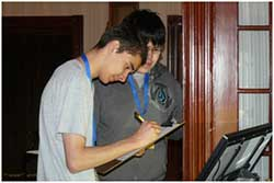 Two students working on a scavenger hunt.